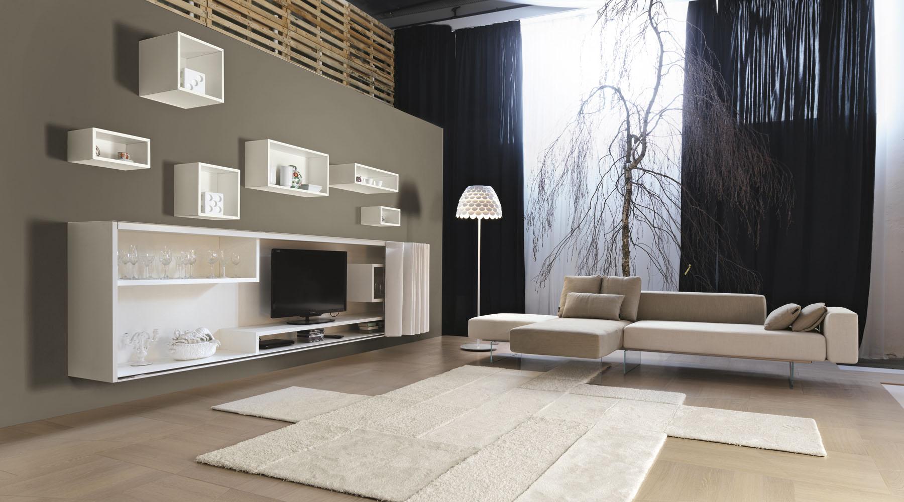 Soggiorno-di-design-Lago-armadio-con-anta-a-scomparsa-e-divano-sospeso